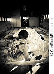 sexy young adult wedding couple laying in the fuselage of...