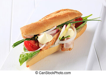 Chicken sub sandwich - French bread filled with vegetables...