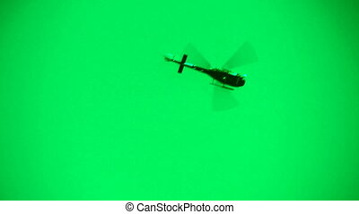 Green helicopter - A helicopter flies overhead Green sky