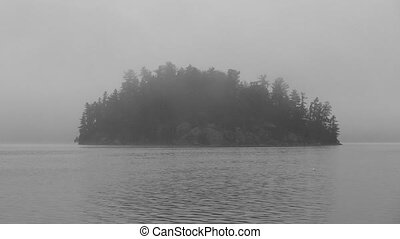 Misty Island. Black and white.