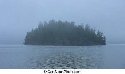 Misty Island. - Island on lake with morning mist.