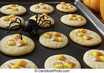 Candy Corn Cookies - Pan of candy corn cookies with a black...