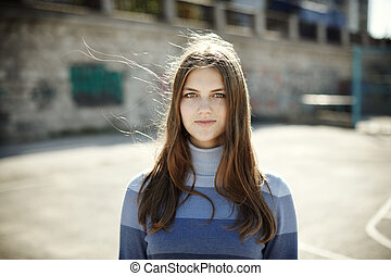 natural portrait of the girl - sunny day and wind