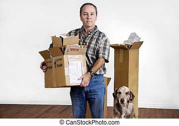 Middle age man and dog moving out - MIddle age man and dog...