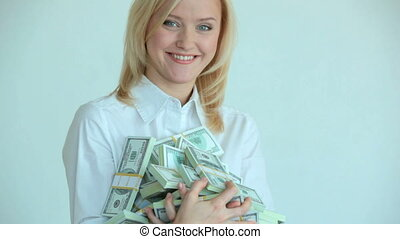 Successful leader - Pretty blonde holding heap of dollar...