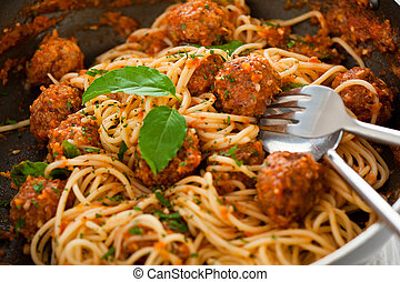 Original Italian spaghetti with meatballs in tomato sauce