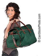 Woman carrying a weekend bag over her shoulder