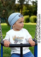 cute  boy on a swing