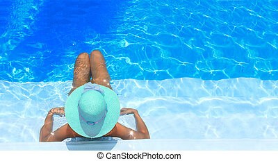 woman enjoying a swimming pool - Pretty blonde woman...