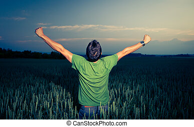 Young man enjoying his freedom/rejoicing from his success in...