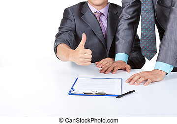 businessmen - business people holding hand with thumbs up...