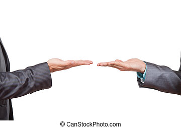 businessmen - Two businessmen standing and holding hands...