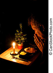 Dinner for One at Christmas - A lonely man praying over a TV...