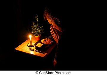 TV Dinner Christmas - A middle-aged man praying over a...