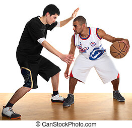 Two sportsmen playing basketball - Young men - white and...