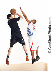 Two basketball players - Two young men in basketball uniform...