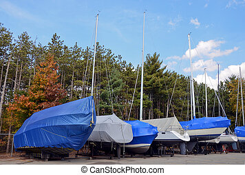 winterized boat - Row of boats with winterized covers.