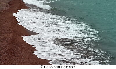 Coastline - Bright terracotta sand and clear water