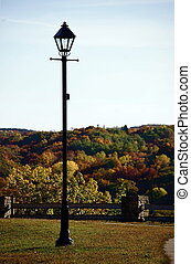 Lamp post with fall background