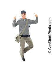 achievement - Shot of a happy jumping young man. Isolated...