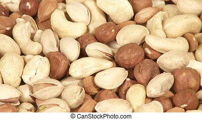 Variety of nuts close-up - Close-up macro video of mixed...