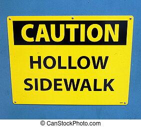 caution hollow sidewalk