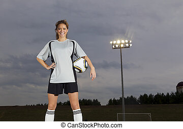 Female Soccer Player - Female soccer player working out on a...