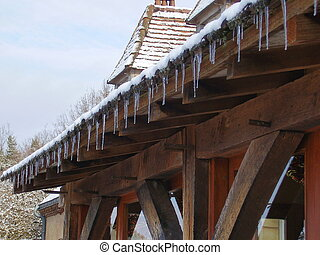 Icicles hanging from a roof - Icicles hanging from the roof...