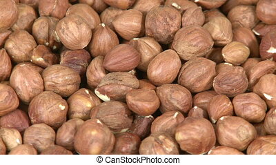 Hazelnuts background close-up - Pile of healthy hazel nuts...