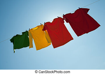 Sunshine behind colorful clothes on a laundry line