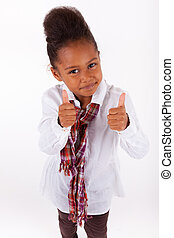 Cute little African Asian girl making thumbs up - Adorable...