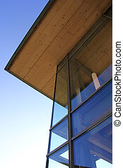 glass facade - the modern glass facade with wooden ceiling