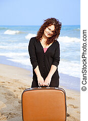 Redhead girl at outdoor with suitcase