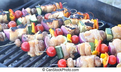 Grilling Shish Kabobs - Skewered shish kabobs of chicken,...