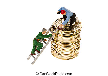 Building Wealth - Toy men working on a stack of golden coins...