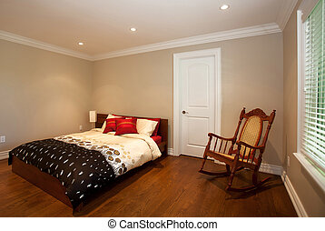 Bedroom with a rocking chair