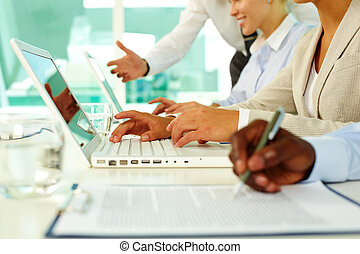 Computer work  - Female hands typing on computer in office
