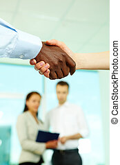 Companionship - Shaking hands in office after conclusion of...