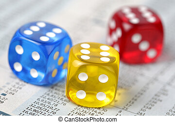 Dice on financial report - Colorful dice on financial report