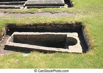 Empty grave at the medieval cemetary of St. Andrews in...