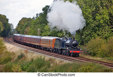 Steam excursion - Vintage steam train taking passengers on...