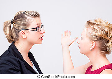 Conflict at workplace - Two young business women conflict.
