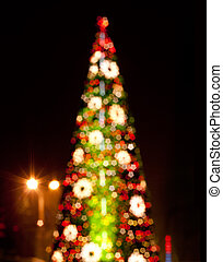 Christmas tree with blurred lights on black background
