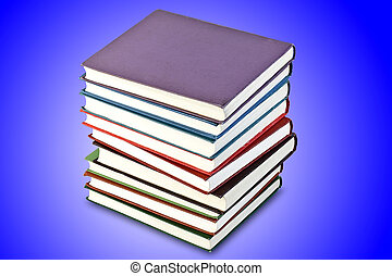 a stack of old books in the blue, isolated