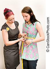 Dressmaker - Young dressmaker with her customer
