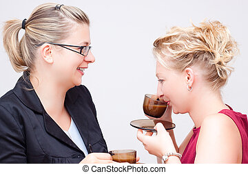 Business coffee break - Two young business women having...