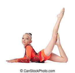 Young teenager girl doing gymnastics pose
