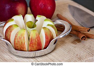 Freshly Sliced Apples and Cinnamon Sticks - An apple sliced...