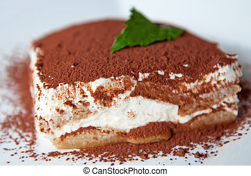 Tiramisu - Detailed view of tiramisu cake on a white...