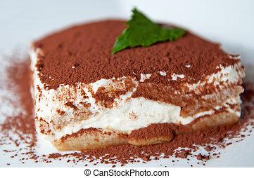 Tiramisu - Detailed view of tiramisu cake on a white...